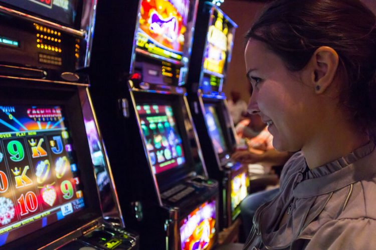 Find-best-paying-slots-feature-picture-lady-plays-slot machine-Las-Vegas